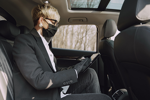 Woman wearing mask in shuttle car